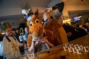 A pantomime horse drinks shots of Jägermeister.