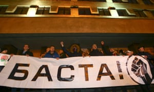 People in Minsk hold a banner that reads 'Basta!' (Enough).