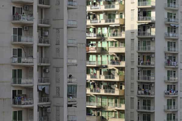 People clap and bang utensils from their balconies