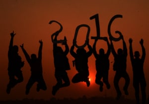 A group of young people in Allahabad, India, jump for joy as the sun sets on the last day of 2015