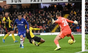 Christian Pulisic scores Chelsea's second goal past Watford's Ben Foster.