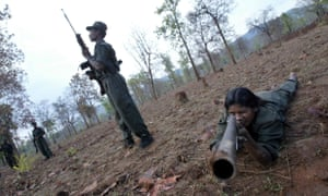 Members of Naxalites, officially the Communist Party of India (Maoist), exercise at a temporary base in the Abujh Marh forests, Chhattisgarh, 2007.