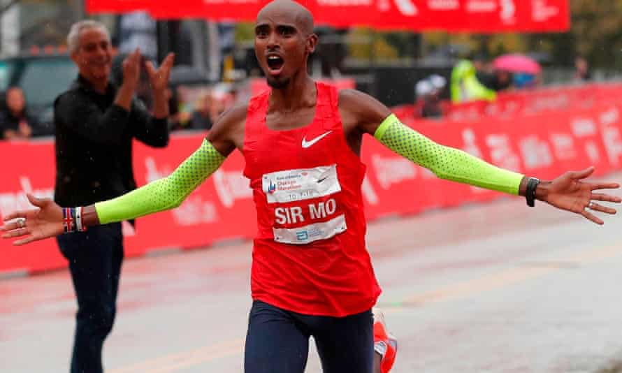 Mo Farah celebrates as he crosses the finish line to win the Chicago marathon in October.