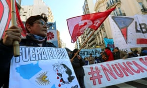 A demonstrator holds an anti-IMF sign during a protest against the G20 Meeting of Finance Ministers in Buenos Aires, Argentina, in July.