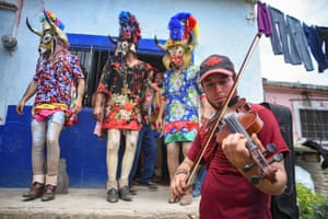 Veracruz, Mexico. Inhabitants of Alto Tio Diego celebrate the traditional carnival, where a group of masked men dance through the streets to celebrate