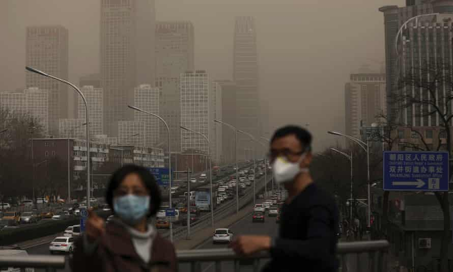 People wearing facemasks in Beijing, China, in 2018