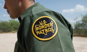 A US Border Patrol agent walks on the river road by the US-Mexican border at the Rio Grande River, near McAllen,Texas.