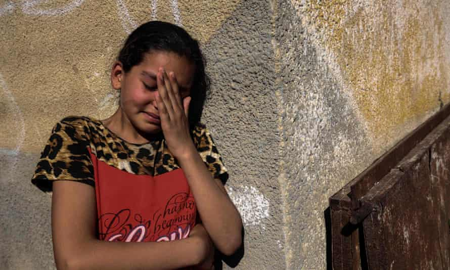 A relative of Palestinian Mahmoud Abu Taima, who was killed during a protest at the Israel-Gaza border, mourns during his funeral