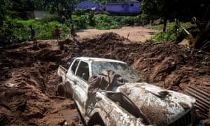 A body was recovered from under the mud after heavy rains caused by flooding in Marianhill near Durban, South Africa.