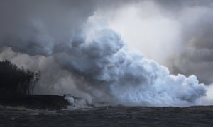 Steam plumes rise as lava enters the Pacific Ocean, after flowing to the water from a Kilauea volcano fissure.