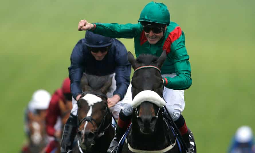 Pat Smullen celebrates as Harzand passes the winning post in Saturday's Derby at Epsom.