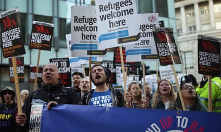 'Stand Up to Racism' campaigners demonstrate outside the Conservative party conference in Manchester