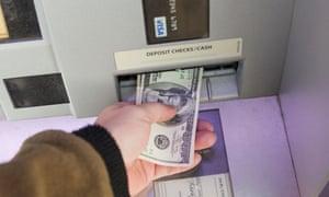 Man depositing money into ATM