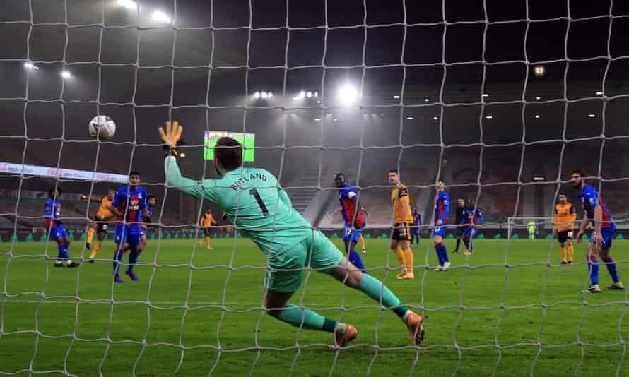 Jack Butland is beaten as Adama Traoré scores a rare goal in the FA Cup tie between Wolves and Crystal Palace.