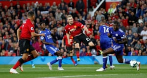 The marauding Luke Shaw fires in a shot saved by Schmeichel.