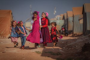 Syrian children are seen at a camp for internally displaced people during Eid al-Adha in Idlib, Syria