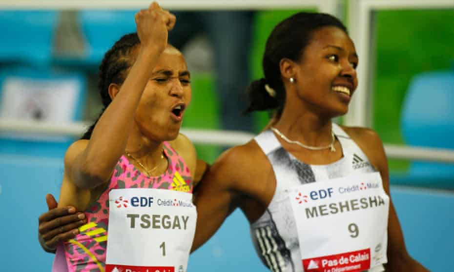 Gudaf Tsegay (left) celebrates winning the women's 1500m in Liévin and setting an indoor world record time of 3min 53.09sec.
