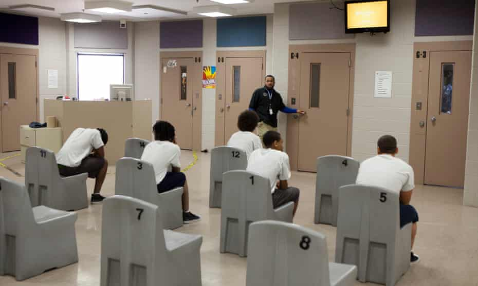 Juvenile offenders wait to go to the gym inside the Juvenile Detention Center, in Toledo, Ohio.