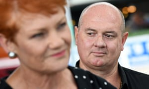 One Nation candidate Mark Thornton looks on as Pauline Hanson speaks at a press conference in Townsville