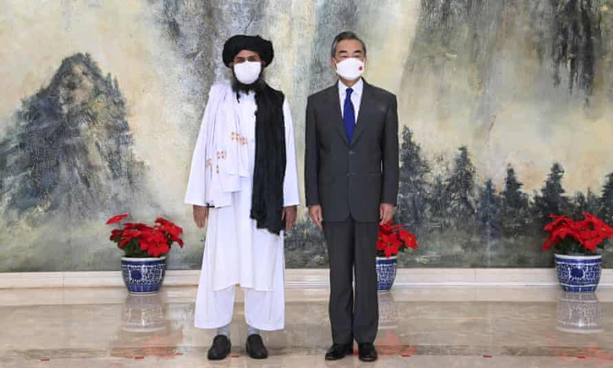 Mullah Abdul Ghani Baradar, left, the Taliban co-founder, and the Chinese foreign minister, Wang Yi, meeting in Tianjin, China, on Wednesday.