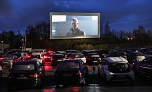 Hundreds of people watch a trailer at a drive-in cinema in Essen, Germany