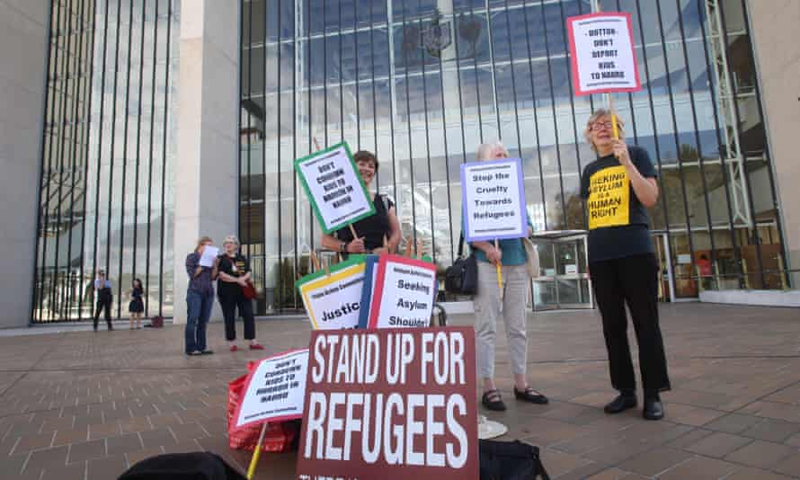Protesters outside the high court in Canberra on Wednesday morning. The court ruled that the government's offshore detention regime is lawful under the constitution.