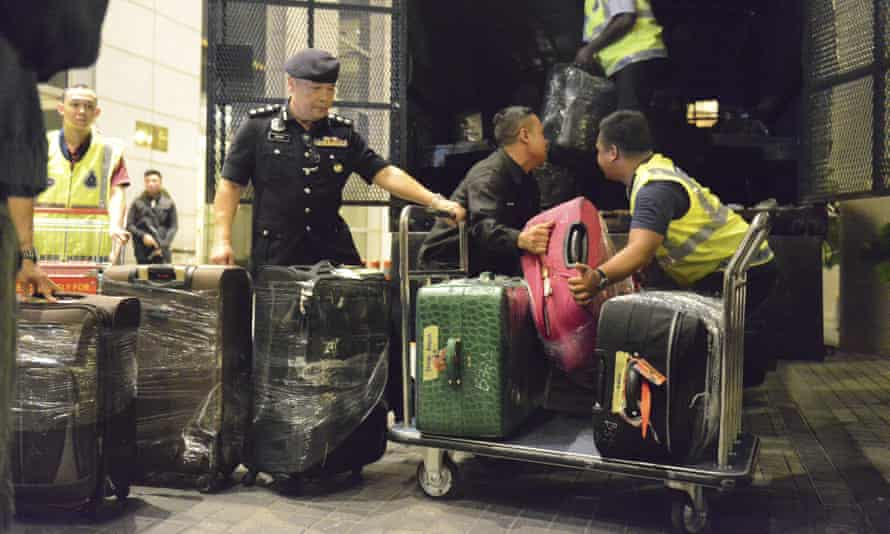 Malaysian police confiscated a few hundred designer handbags and dozens of suitcases containing cash, jewellry and other valuables as part of a corruption and money-laundering investigation into former Prime Minister Najib Razak.