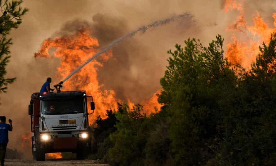 Emergency services try to extinguish a wildfire in northern Athens, Greece