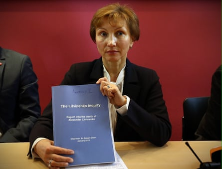 Marina Litvinenko in 2016, holding the results of the inquiry into the death of her husband Alexander.