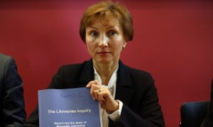 Marina Litvinenko holds a copy of the inquiry report  inquiry into the death of her husband.