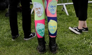 A woman wears tights showing the face of Jeremy Corbyn at a rally in Birmingham.