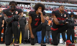Eli Harold, Colin Kaepernick and Eric Reid of the San Francisco 49ers kneel in protest prior to their NFL game against the Arizona Cardinals