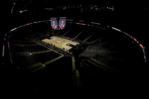 Big 12 commissioner Bob Bowlsby is seen on the big screen in an empty Sprint Center as he talks to the media after canceling the remaining NCAA college basketball games in the Big 12 Conference tournament due to concerns about the coronavirus Thursday, March 12, 2020, in Kansas City.
