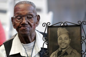 Louisiana, USLawrence Brooks holds a photo of himself taken in 1943, as he celebrates his 110th birthday at the National World War II Museum in New Orleans.Brooks was born in 1909, and served in the predominantly African-American 91st Engineer Battalion, which was stationed in New Guinea and then the Philippines during World War II.