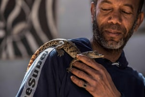 Mamdouh Hassan with a baby crocodile