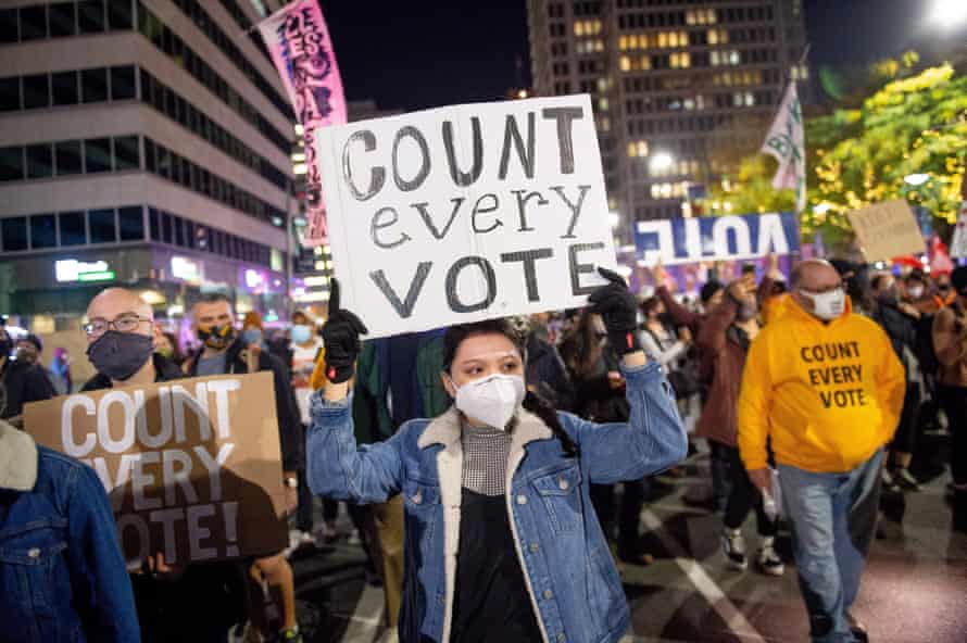 Protesters call for continued vote counting in Philadelphia, Pennsylvania, despite efforts by the Trump campaign to halt the process.