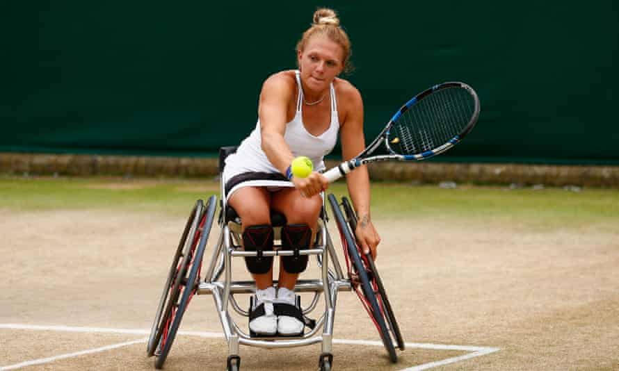 Jordanne Whiley playing in a doubles match at Wimbledon in 2015