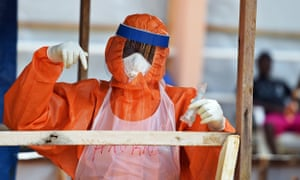 A health worker at a treatment centre near Freetown, Sierra Leone, during the 2014 Ebola outbreak.