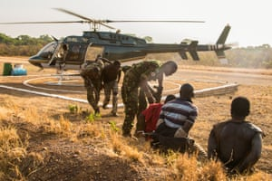 Suspected poachers caught in Chinko arrive at the park's main base. Rangers put them in handcuffs, sit them down together, then take them to a holding cell. The moment is the culmination of a week-long operation by Chinko's law-enforcement and aerial patrol teams.