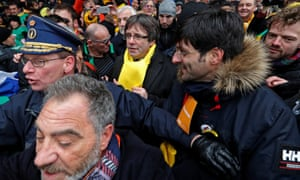 Carles Puigdemont, wearing a yellow scarf, at the Brussels rally in support of Catalonia's independence.