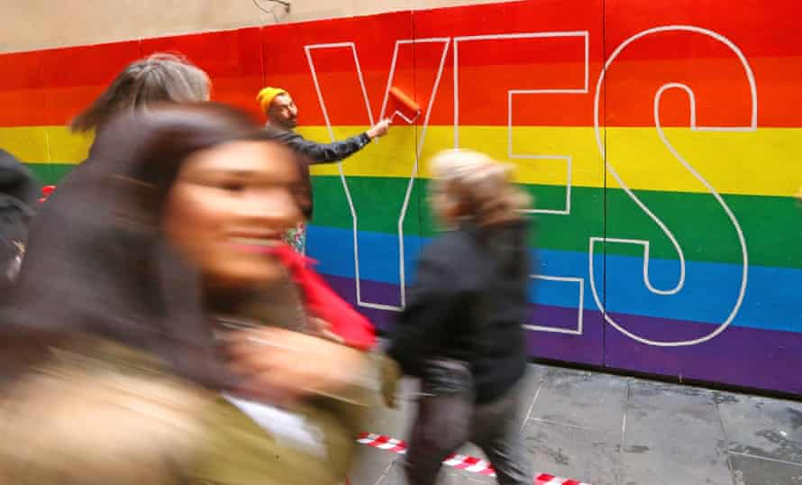 Street artists paint a rainbow mural in Melbourne in support of marriage equality.