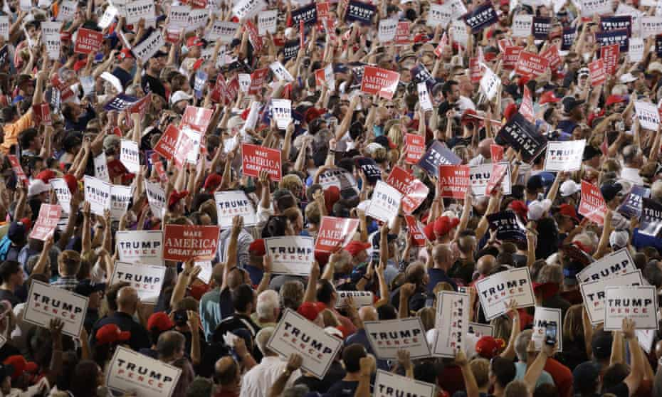 People cheer while waiting for Republican presidential candidate Donald Trump to speak at a rally.