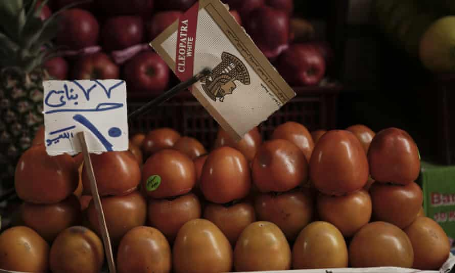 Tomatoes for sale for 10 Egyptian pounds (93p) a kilogram in Tawfiqia market in Cairo.