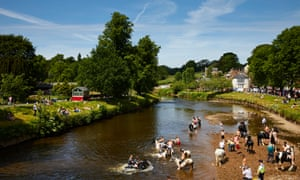 Visitors wash their horses in the River Eden on the first day of the Appleby horse fair, Europe's largest gathering of Travellers and Gypsies, held annually in the Cumbrian town since at least 1775.