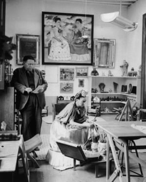 Diego Rivera and Frida Kahlo. Kahlo's self-portrait, The Two Fridas (1939), hangs in the background.