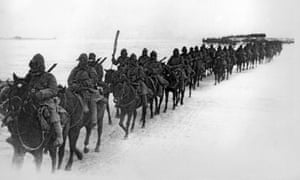 Japanese cavalrymen bundle up against the bitter cold of northern Manchuria, as they advance against the Chinese forces, circa 1935.