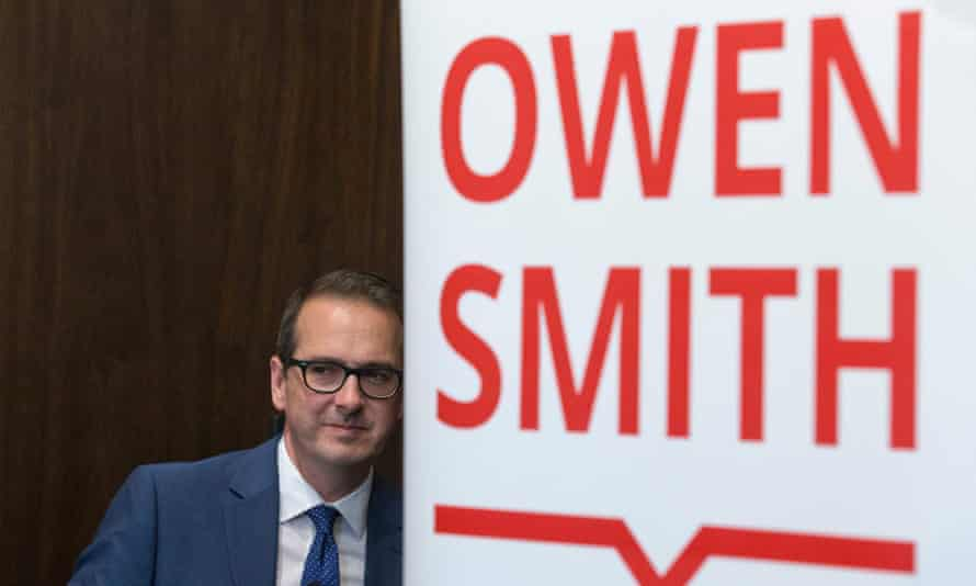 Owen Smith leaves after delivering a speech at a press conference in London