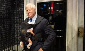 A waxwork of Boris Johnson wearing a baby carrier at Madame Tussauds in west London