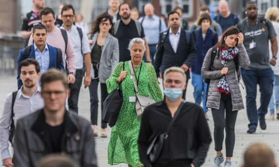 Commuters on London Bridge. Prof Sir Andrew Pollard, director of the Oxford Vaccine Group, said: 'The Delta variant will still infect people who have been vaccinated.'
