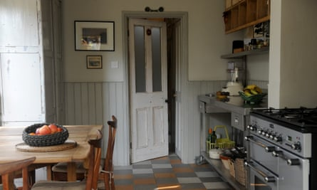 a victorian kitchen space with secondhand wood and stainless furniture and appliances